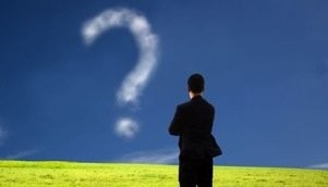 Businees Man Thinking And Looking At Cloud Question Mark