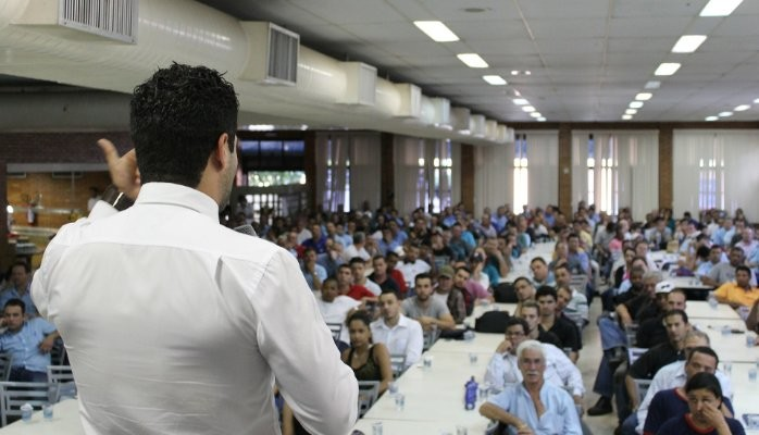 Business Man Speaks To A Large Crowd