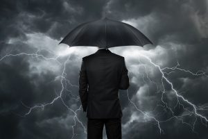 Business Man With Umbrella And A Thunderstorm