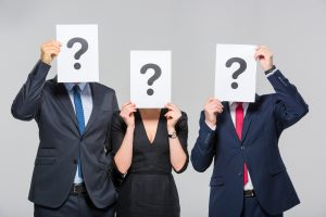Business People With Question Marks Obscuring Their Faces