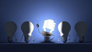 Four Lightbulbs And One Illuminated Light Bulb