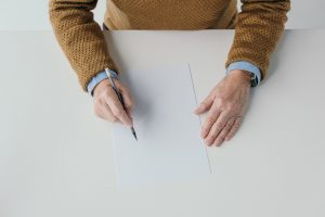 Older Man With Pencil And Blank Paper