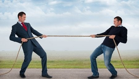 Two Men Tug Of War With Rope