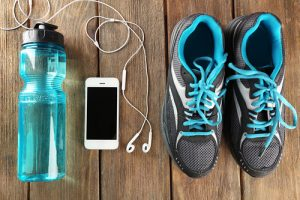 Water Bottle With Audio Device Headphones And Running Shoes
