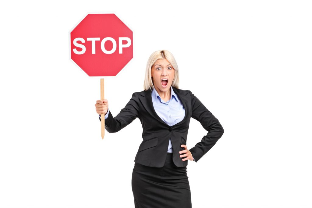 Woman Holding A Road Stop Sign
